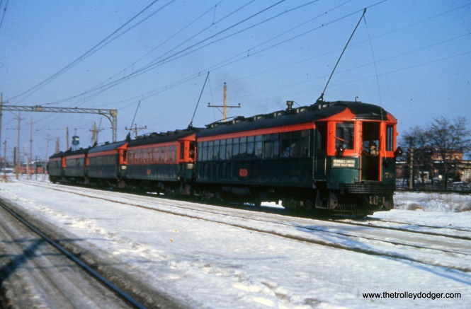 Here is a northbound five-car North Shore Line train at Great Lakes on December 30, 1951, with 706 at the rear.