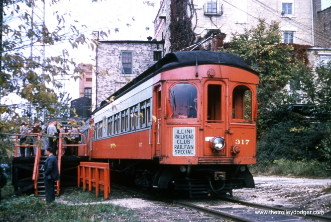 Chicago, Aurora & Elgin woods 317 and 316 went to the end of the line on the Batavia branch on an Illini Railroad Club fantrip on October 16, 1955.