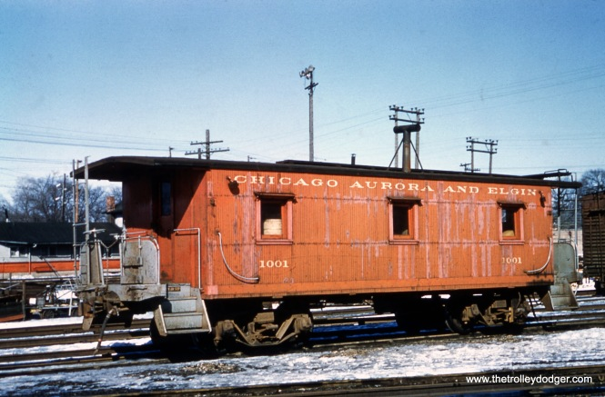 CA&E caboose 1001 at Wheaton, February 21, 1959. This was just prior to the end of freight service on the railroad. Passenger service ended on July 3, 1957, except for a few charters.