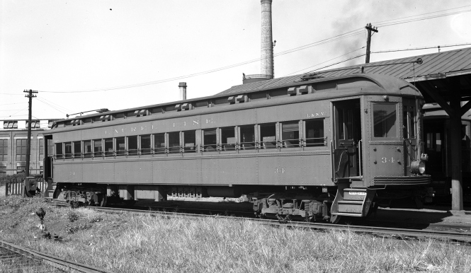 "Here is Lackawanna & Wyoming Valley (better known as the Laurel Line) car 34 at the Scranton (PA) station on September 21, 1941. Don's Rail Photos says, ""34 was built by Osgood-Bradley Car Co in 1924. It was sold to John C Bauman in 1953 and scrapped in 1956."" The question has been raised in the past, as to whether the Laurel Line fleet, retired in the early 1950s, could have been any use to the Chicago, Aurora & Elgin, which needed to replace their wood cars with steel. It would appear that these cars were too long for the CA&E and would have needed modification. However, such changes had been made in 1937-38 to eight ex-Washington, Baltimore & Annapolis cars, which were renumbered into the 600 and 700-series. What was lacking in 1953, unfortunately, was the will to keep operating and investing money in a railroad that management thought was worth more dead than alive."