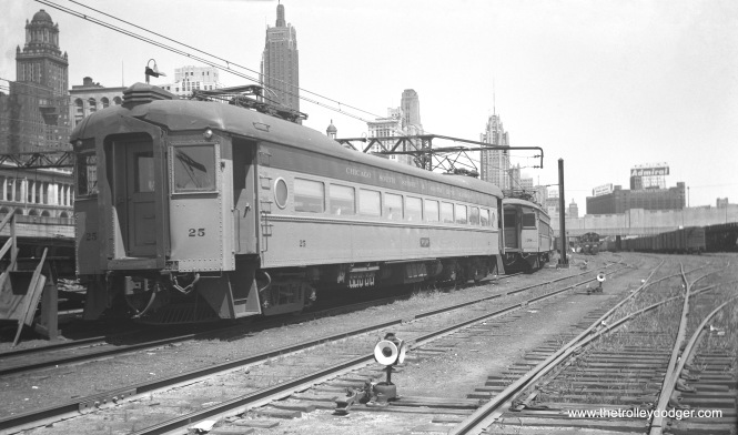 This picture of South Shore Line cars 25 and 38 at Randolph Street is dated 1954, but an earlier date seems likely as there is no sign of the Prudential Building. Construction began on August 12, 1952, and the building was topped off on November 16, 1954. There was also a large sign advertising Pabst beer, not visible in this picture. Perhaps it had already been removed by the time this picture was taken. (Walter Hulseweder Photo)