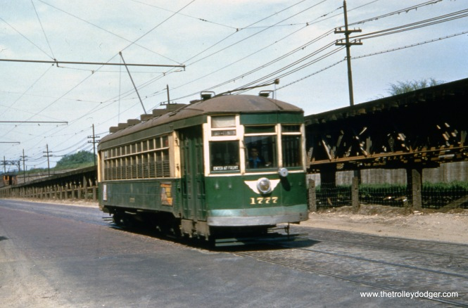 """CTA 1777 is on Lake Street heading east near Laramie, next to the ramp that once took the Lake Street """"L"""" up to steel structure. A few of the older red trolleys were repainted in this color scheme by CTA, but I don't know anyone who found this very attractive when compared to what it replaced. The total dist"""