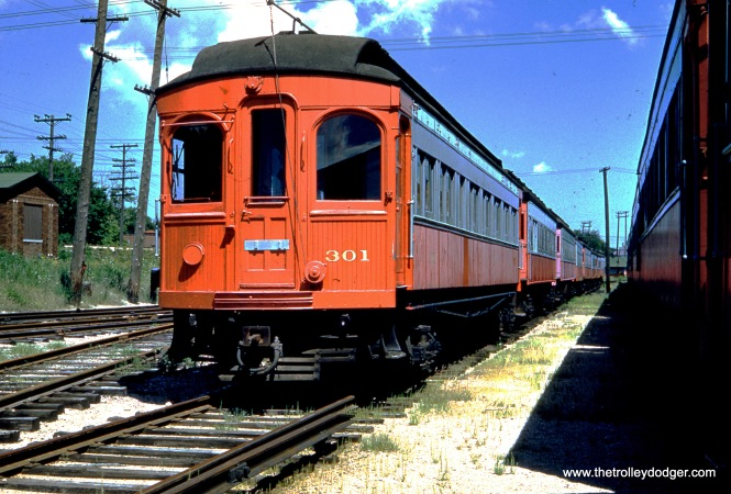 Chicago Aurora & Elgin wood car 301 sports a new paint job at Wheaton Yard in August 1959, two years after the end of passenger service. It sits forlornly while waiting for a buyer that never came. Fortunately, some other cars were saved.