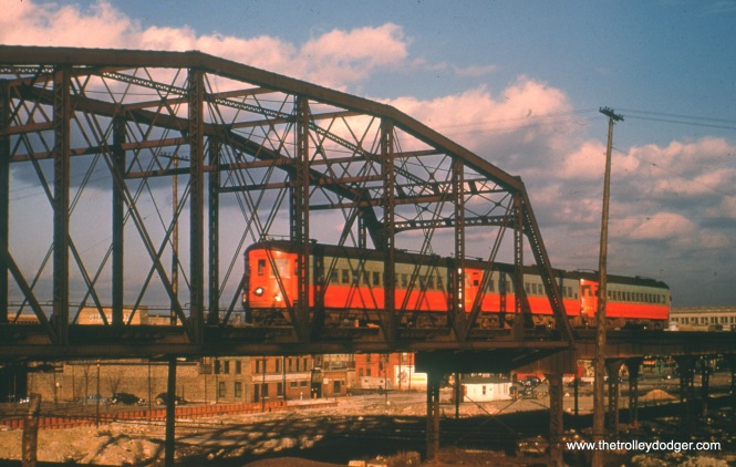 A westbound CA&E train crossing over the C&NW/PRR at Rockwell, shortly before sundown.
