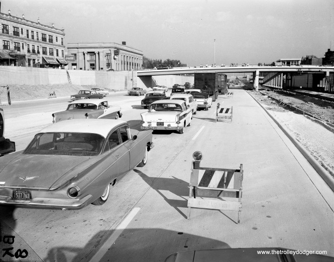 In this picture, it looks like the Congress Expressway (now Eisenhower) has just opened, which would date the picture to November 1960. We are looking east near Oak Park Avenue. Many things are unfinished, and traffic is limited to two lanes in each direction (and already very crowded). According to Graham Garfield's excellent web site, the new Oak Park station opened on March 19, 1960, and the station house was finished on March 27, 1961.
