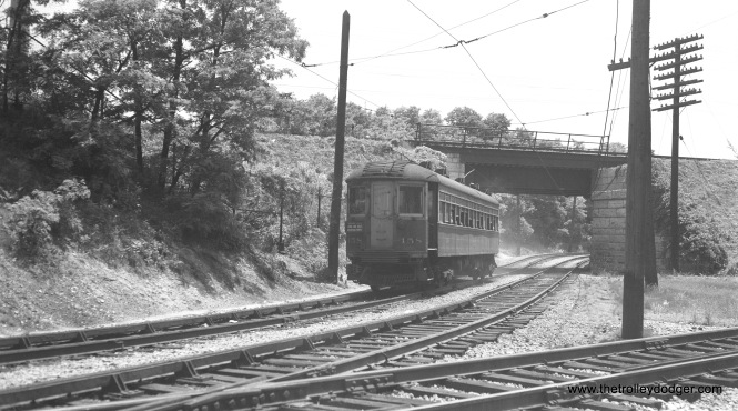 North Shore Line car 158 is a northbound Waukegan Express on the Shore Line Route at North Chicago, July 4, 1949. This was the also date of an Electric Railroaders Association (ERA) fantrip. 158 was built by Brill in 1915.