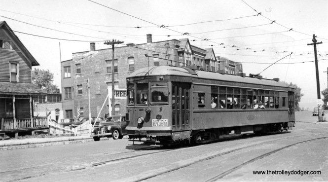 "North Shore Line city streetcar 356 in the 1940s. The consensus is this shows Waukegan, as there was no curve in Milwaukee that matches the buildings in this picture. Jerry Wiatrowski adds, ""This is in Waukegan! The photographer is standing on the South side of Belvidere Street looking East/Northeast. The Westbound streetcar is turning off of Marion Street (now South Genesee Street) and will shortly turn right onto South Genesee Street as it travels North thru the center of downtown Waukegan. If I recall correctly, the ""s-curve"" this streetcar is on was known as ""Merchants curve"". The sailors that can be seen in the windows of the car are going to downtown Waukegan from the Great Lakes Naval Base, the South end of the streetcar line."""