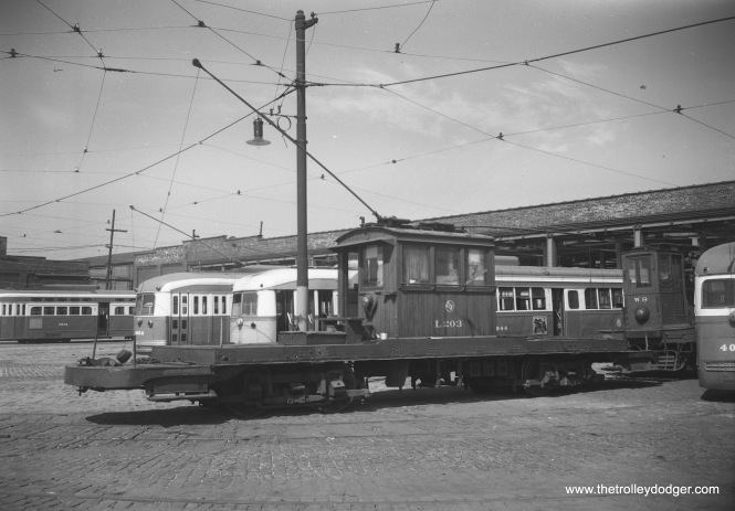 CTA work car L-203 and various PCCs parked behind South Shops on September 10, 1952.