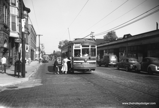 """Here, one-man car 3266 is on the south side (Route 67). The car is at Harvard, heading westbound, and I believe the destination sign reads 79th and California. On the other hand, our resident south side expert M. E. writes: """"In pict662.jpg , your caption says """"I believe the destination sign reads 79th and California."""" No, it is 71st and California. Route 67 was known as 67th-69th-71st; abbreviated, just 69th, because that was the longest stretch. In fact, you might want to revise the caption to note that the photo is at 69th and Harvard."""""""