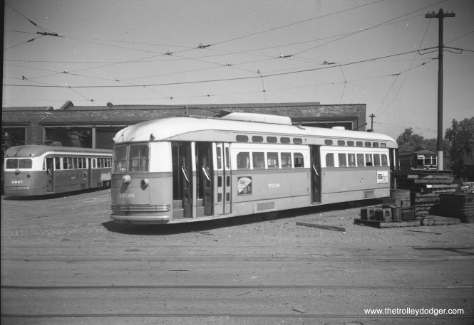 CTA prewar PCC 4047 and postwar car 7038 at South Shops on September 10, 1952.
