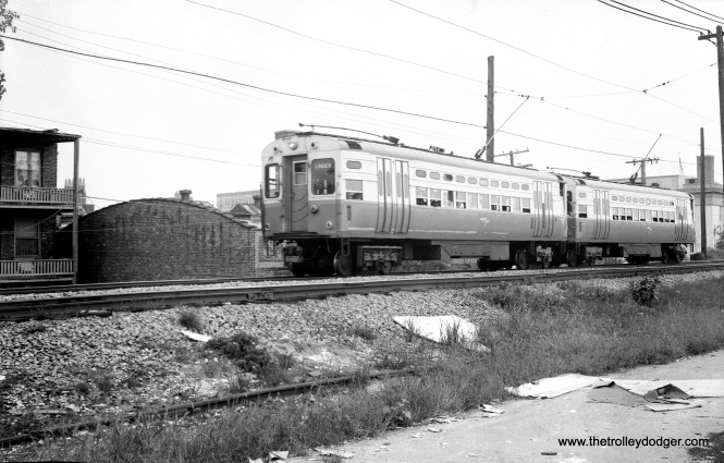 A two car train of singles just north of Main Street in Evanston. #27 is the lead car.