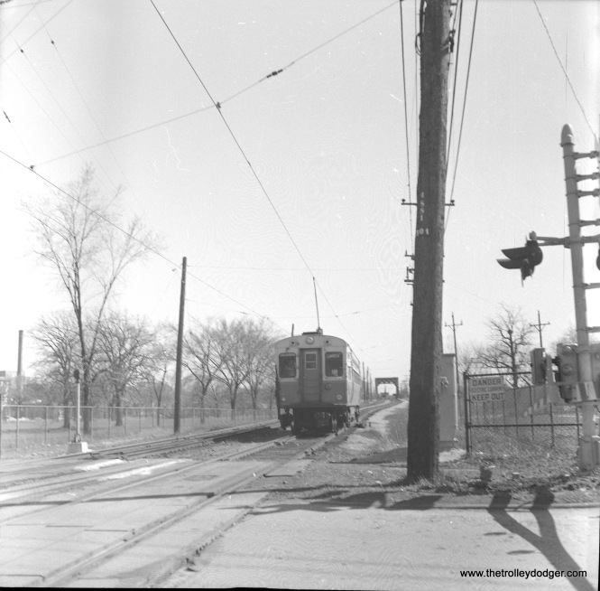 A CTA single-car unit heads south from Isabella on the Evanston branch, sometime between 1961 and 1973.
