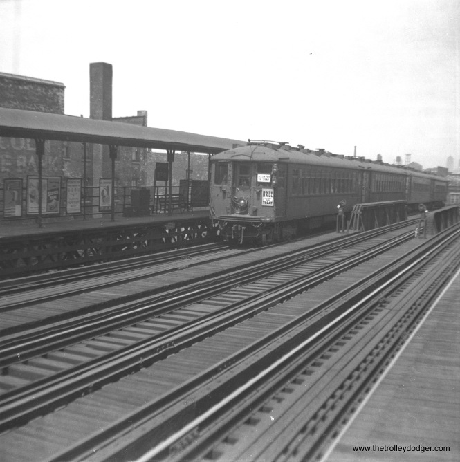 "A train of 4000s, signed for Jackson Park via the Subway, in 1947. If I am reading the sign correctly, this is 31st Street, a station the CTA closed in 1949. There was also apparently a Chicago White Sox home game when this picture was taken. M. E. writes: ""pict673.jpg features a Jackson Park train at 31st St. Notice three tracks. The middle track was used, although I am unsure under what circumstances. One possibility that comes to mind is that the Kenwood line (until it became a shuttle out of Indiana Ave.) ran on this trackage into the Loop and up to Wilson. The Kenwood was a local. The Englewood and Jackson Park trains sometimes bypassed the Kenwood locals using the middle track. There were switches up and down the line to enable moving to and from the middle track. Another possibility is that at one point the North Shore ran trains south as far as 63rd and Dorchester (1400 East) on the Jackson Park line. Perhaps some CNS&M trains used the middle track. One impossibility is that the Englewood and Jackson Park trains used the middle track the whole way from south of Indiana Ave. to the Loop. I say this was not possible because all the stations on this line were on the outer sides of the outside tracks. I don't recall any Englewood or Jackson Park trains running express on the middle track along this stretch. By the way, prior to the 1949 changes, only the Jackson Park line ran north to Howard. The Englewood ran to Ravenswood (to Lawrence and Kimball)."""