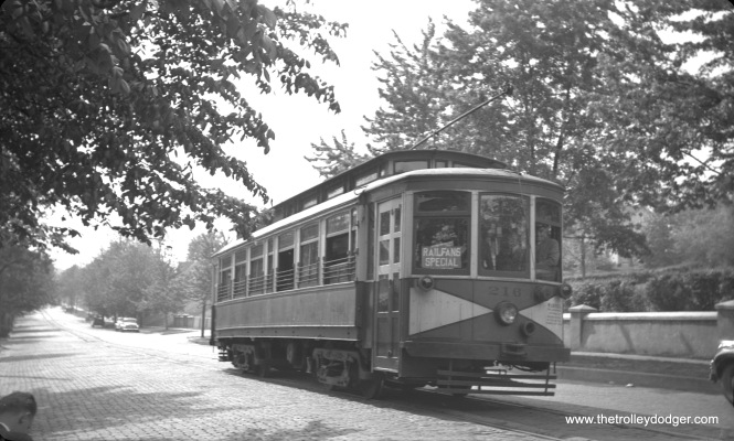 Northern Indiana Railways 216 in South Bend, Indiana on June 25, 1939. The occasion was Central Electric Railfans' Association fantrip #9, which brought people here via the South Shore Line. This deck roof car was built by Kuhlman in 1923.