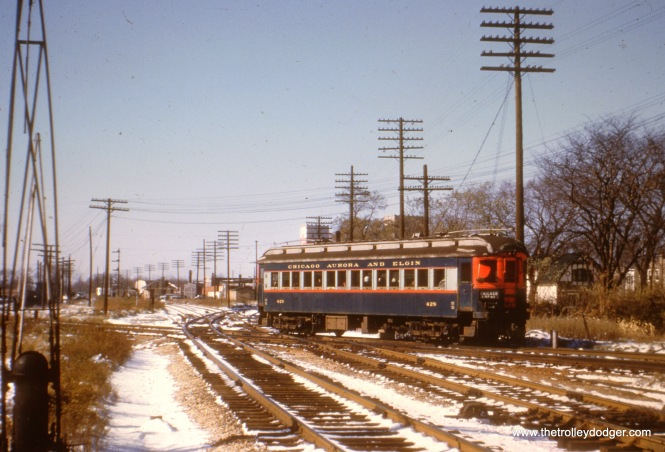 Westbound CA&E car 428 crosses the B&OCT in Forest Park. This was also where the Chicago Great Western, now long abandoned, branched off.