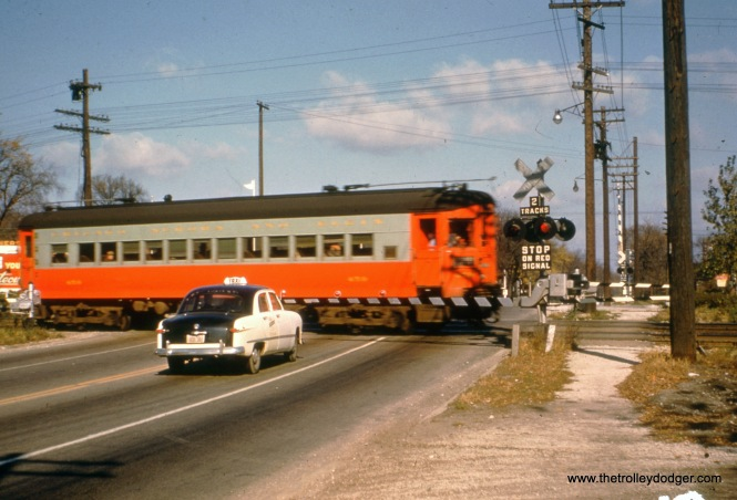 One of the St. Louis-built 1945 cars (454?) crosses First Avenue in Maywood, heading east. We are looking north. There was a Refiner's Pride gas station located between the CA&E and Chicago Great Western tracks, on the west side of First.