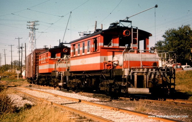 "According to what's written on this slide, CA&E locos 4004 and 4005 are in North Aurora in August 1952. On the other hand, Bill Shapotkin writes: ""This pic is Aurora Ave on the Aurora Branch."""
