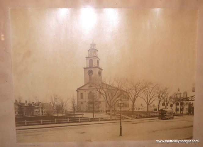 "While visting the Simon Willard House and Clock Museum, I was intrigued by this early photograph, which shows a horse car near the First Church of Roxbury. The picture was dated as ""circa 1910,"" but must have been taken many years before that."