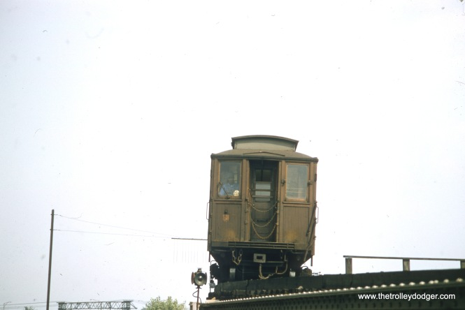 A wooden Met car on the CTA's Kenwood shuttle in August 1957, just a few short moths before this branch line was abandoned. The CTA (and CRT before it) was a tenant and this complicated operation of the line. In addition, the CTA during this period closed several branch lines, in their efforts to consolidate and streamline service.