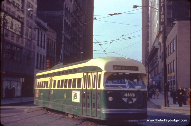 Postwar Pullman PCC 4112, signed to go west on the Madison-Fifth branch of Route 20, turns onto Franklin Street, probably in the early 1950s.