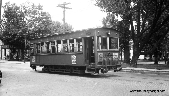 This odd, boxy streetcar is Black River Traction car #1 in Watertown, New York. This was a 1906 product of the Barber Car Co. Some consider this an ugly design, but apparently these cars were well-built. Apparently this line abandoned streetcar service on August 17, 1937, but this negative is dated June 20, 1938. The sign on the side of the car doesn't really solve this mystery-- there were two championship heavyweight bouts between Joe Louis and Max Schmeling, and these took place on June 19, 1936 and June 22, 1938. For more information on the Barber Car Company, click here.