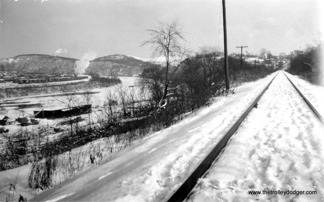 "Picture caption: ""1947 snow (2 ft.). This taken off Monongahela tracks just below our house. B&O yards across river."""