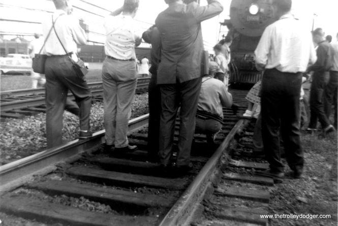Always remember...never step on any rails. Right? (Photo stop bedlam, September 1958.)