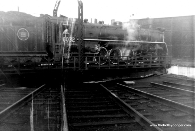 There wasn't much I could do about the scratches on this picture, but how often have you witnessed a steam locomotive on a turntable? (November 1958)