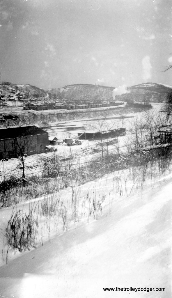 "Winter 1947-48. ""Same as other, only vertical. Big building, left foreground, is Interstate Construction & Engineers... build coal tipples."""