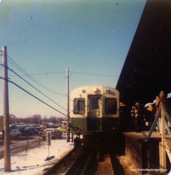 CTA 6000s in Forest Park , December 22, 1976.