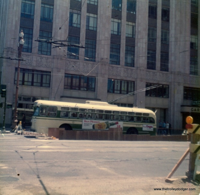 An SF Muni trolley bus on Market Street, May 27, 1974. Looks like construction may already have been underway on the Muni Metro subway.