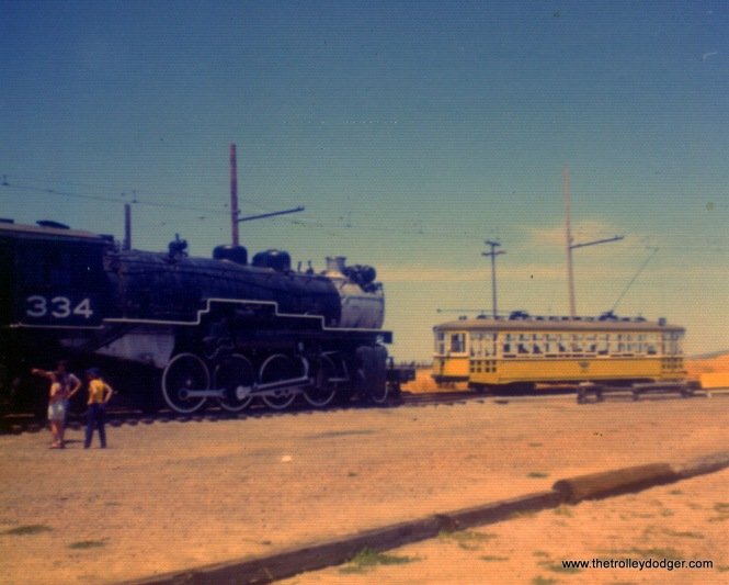 I'm wondering if the streetcar at right is Key System 987. The steam loco is Western Pacific 334, a 2-8-2 built in 1929 by American Locomotive. We see both at the Western Railway Museum on May 26, 1972.