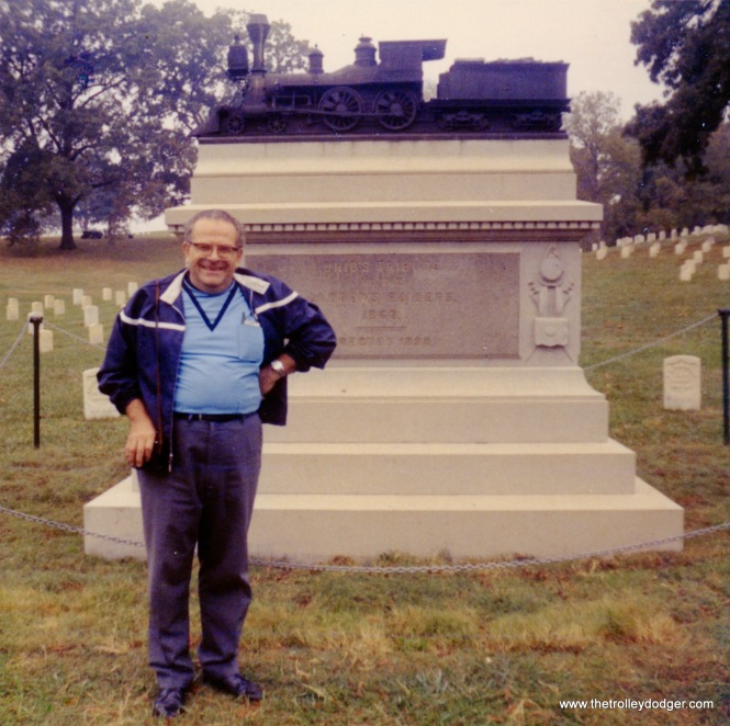 "Marvin C. Kruse at the Andrews Raiders Memorial in the Chattanooga Military Cemetery on October 23, 1907. According to Find-a-Grave: :""Memorial erected by the State of Ohio to the Andrews Raiders. In early April, 1862, a band of Union soldiers lead by civilian James Andrews infiltrated south from the Union lines near Shelbyville, Tennessee and met at Big Shanty, Georgia (near Marietta). On the morning of April 12, 1862, 20 of them (2 raiders never arrived and 2 others overslept and missed the adventure) stole the passenger train ""The General"" during its morning breakfast stop. With the farms and factories of Georgia supplying the Confederate Army fighting further west, the Raiders' mission was to burn the railroad bridges between Atlanta and Chattanooga, thus isolating the Confederate Armies from their supply sources and enabling the Union Army to seize Chattanooga. Due primarily to the persistency of William Fuller, conductor of the stolen train, and, secondarily to the rainy weather and unlucky miscoordination with the Union Army to the west, the Raiders failed. All 22 at Big Shanty that morning were captured. Eight, including James Andrews, were tried and hanged by the Confederate Army in Atlanta. In 1866, after the war, they were reburied in a semi-circle at the Chattanooga National Cemetery. On the imposing granite monument, erected in 1891, are the names of 22 of the raiders. The memorial is topped by a bronze likeness of the ""General""."" This story inspired the classic 1927 Buster Keaton film The General."