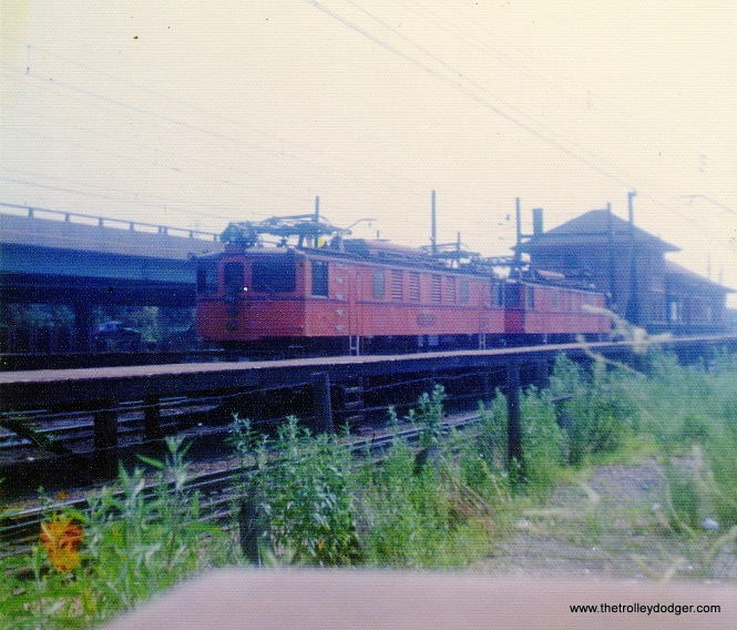 A pair of 700-series South Shore Line freight locos at the Gary, Indiana station in 1974.