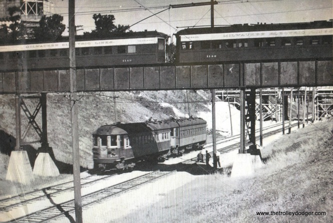 8E NSL 706 heads south passing under the TM Lakeside Belt Line bridge while a two-car CERA Fan trip (using two TM 1100-series cars) makes a photo stop. This 1939 Fan trip, and one in 1948 where car 1122 backed down the Belt Line a short distance from Greenwood Jct. are the only known passenger operations over this line.