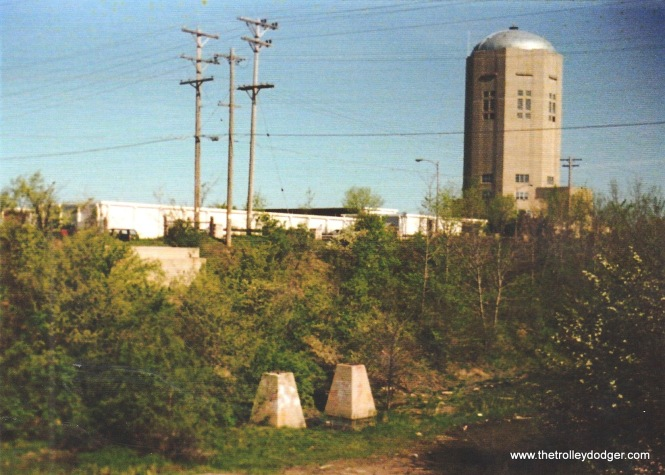8F Abutments from the TM Lakeside Belt Line bridge near W. Waterford Ave. could still be seen in 1988. Here we see two of the piers that held legs of the bridge. C.N.Barney on 5-14-88