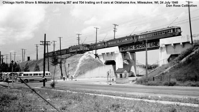 6B NSL city car 357 waits to head back to DT Milwaukee as car 704 leads a 6 car train also headed for downtown in 1948. Note streetcar tracks still in 6th St and Transport Co. buses at left. Don Ross collection