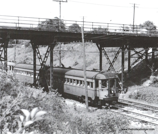 10A Two NSL Silverliners and other cars are southbound at College Ave. Portions of the abandoned r.o.w. were purchased for the south campus of the Milwaukee Area Technical College Oak Creek campus in the 1970s. Bob Genack
