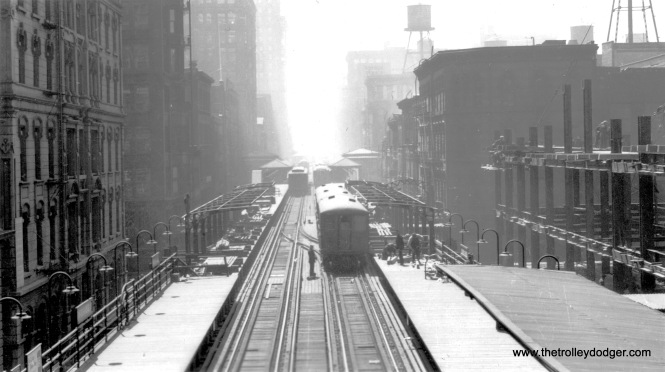 "This picture looks south from Randolph and Wells on the Loop ""L"". The date is not known, but the construction of the building at right may provide a clue. Andre Kristopans writes, ""The overhead shot on Wells showing platform construction is early 20's, when platforms were extended to accommodate longer trains. For instance Randolph/Wells and Madison/Wells were once separate platforms, after the early 20's they were a continuous platform. Also at that time, LaSalle/Van Buren and State/Van Buren were connected and the separate station at Dearborn/Van Buren became an auxiliary entrance to State, until a building next to it blew up in the very early 60's and destroyed the Outer Loop side."""