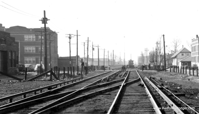 "The view looking west along the Douglas Park ""L"" at 49th Avenue in Cicero on February 4, 1944. The station we see in the background is 50th Avenue. After it closed in 1978, this station was moved to the Illinois Railway Museum in Union, where it is used to board the museum's fleet of retired ""L"" cars."