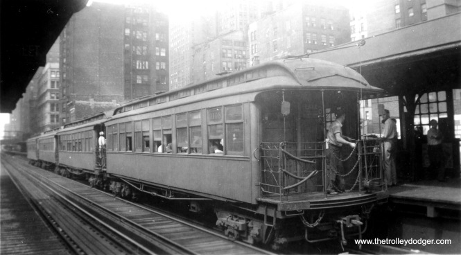 "Wooden gate car 3105 and train in the Loop. This was originally built for the Lake Street ""L"". Don's Rail Photos says, ""3103 thru 3118 were built by McGuire-Cummings in 1893 as LSERR 103 thru 118. In 1913 they were renumbered 3103 thru 3118 and became CRT 3103 thru 3118 in 1923."""