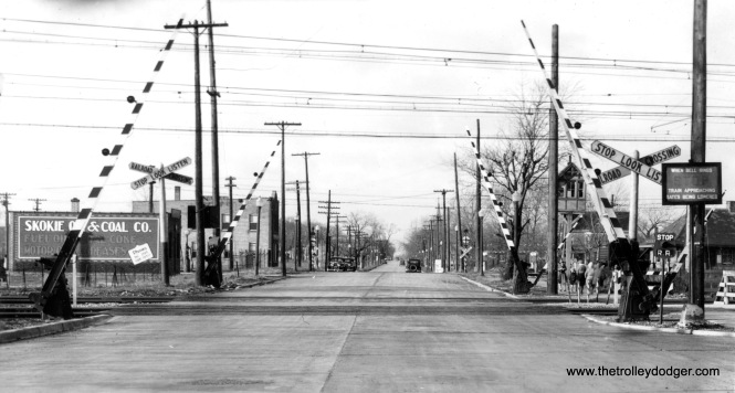 Oakton Street in Skokie on December 11, 1931. The tracks with overhead wire were used by the North Shore Line and the Chicago Rapid Transit Company's Niles Center branch. Both were running on the NSL's Skokie Valley Route, built in 1925. The other set of tracks belong to the Chicago & North Western and were used for freight.