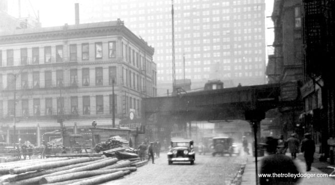 "We are looking west along Harrison at Wabash on November 12, 1928. In 2003, the Chicago Transit Authority straightened out this jog with a section of new ""L"" structure, occupying the area where the building at left once was."