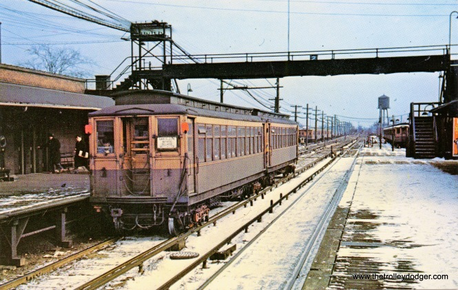 Here, we have a westbound train of wooden Met cars at Laramie on the old Garfield Park line. This was replaced by the Congress line in 1958.