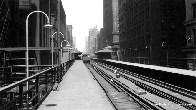 This picture was taken on the Wells leg of Chicago's Loop on April 16, 1926. If this is Quincy and Wells, the scaffolding at left may be related to work being done on the nearby Wells Street Terminal, which started at this time. The terminal got a new facade and was expanded, reopening on August 27, 1927.