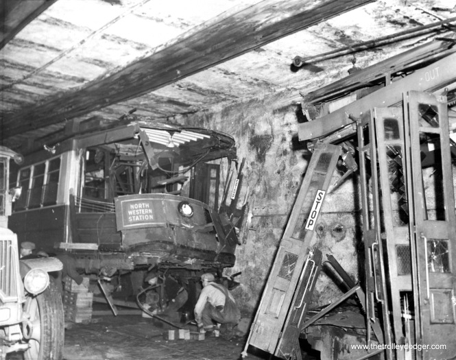 STREET CARS CRASH IN TUNNEL; 7 INJURED Chicago - Its brakes failing to hold as it attempted up-grade run in Chicago street car tunnel, trolley at left slid backward down incline, crashed into front end of following car. Seven passengers were taken to hospital, 100 others shaken up. (Acme Press Photo, November 6, 1941)
