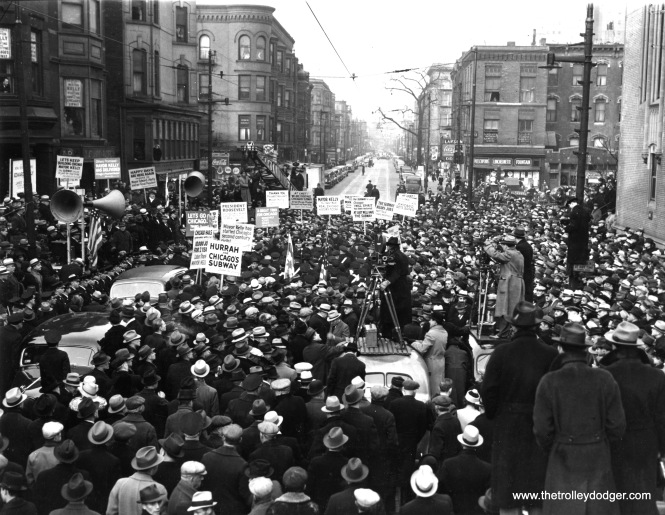 WORK ON CHICAGO'S SUBWAY STARTED Chicago, Ill.: Above photo shows crowd on North State Street at Chicago Avenue during ceremonies marking the start of work on the new subway, which will run under State Street. Mayor Edward Kelly and Secy. of the Interior Harold Ickes used pneumatic spades to start the project. (Acme Press Photo, December 17, 1938)