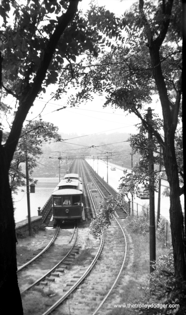 "Cars 19 and 36 on the Strawberry Mansion Bridge over the Schuykill River near Woodford Station on July 9, 1944. The bridge, built in 1896-97 for the trolley company, is still in use, but the section used by the streetcars has only recently been repurposed with a ""pedestrian promenade."""