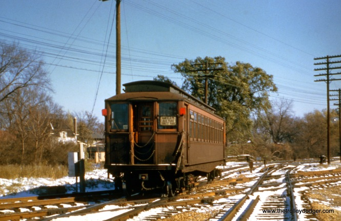 "A westbound Garfield Park ""Met"" car crosses the B&OCT tracks in Forest Park."