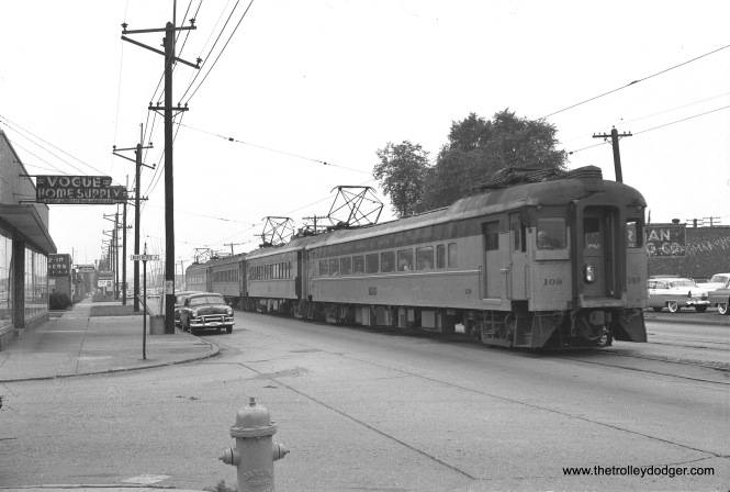 South Shore Line cars 109, 39, 353, and 103 are on west Chicago Avenue at Northcote Avenue in East Chicago, Indiana on July 16, 1956. Not long after this, street running in East Chicago came to an end, as the South Shore began using a new bypass route parallel to the Indiana Toll Road. (James C. Barrick Photo)